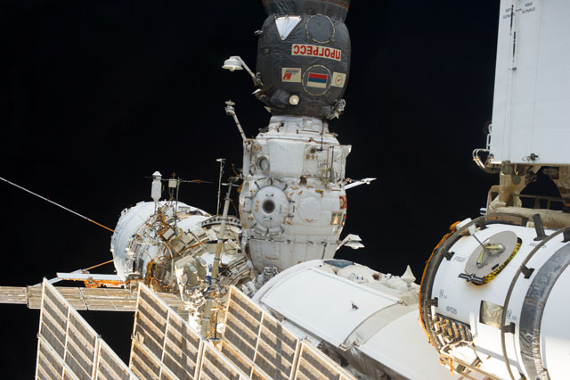 Cosmonauts Retrieve and Replace Science Experiments During Spacewalk