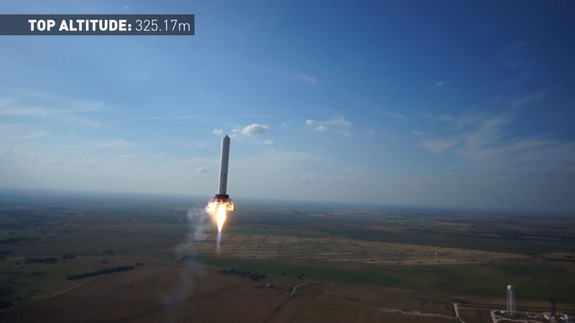 SpaceX's reusable Grasshopper reaches a new record height of just over 1,066 feet (325 meters) on June 14, 2013 during a test flight from its McGregor, Texas proving ground. This image is a still from a video recorded by an unmanned hexacopter drone.
