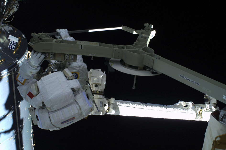 Parmitano on Canadarm, on Way to Port Side