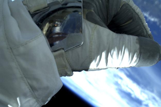 Parmitano's Wrist Mirror Reflects Visor, Reflects Earth