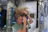 Astronaut Karen Nyberg of NASA uses a squeeze pouch of warm water and no-rinse shampoo to wash her hair on the International Space Station in this still from a video posted on July 9, 2013.