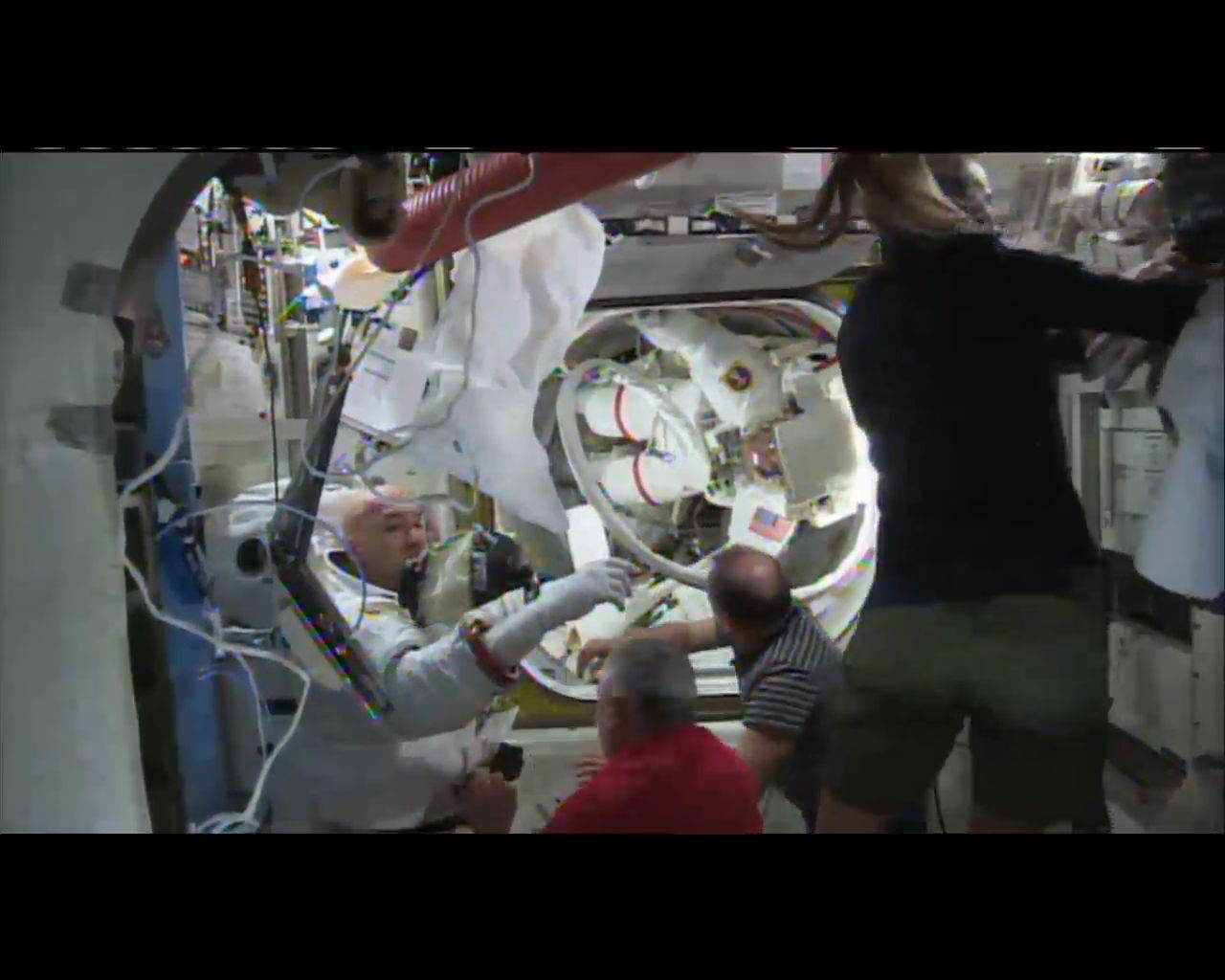 Two Spacewalkers Re-Enter Following Cancellation