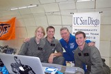 NASA astronaut Mike Fossum poses for a snapshot with the UC San Diego Microgravity Team during a weightless research flight with NASA's Microgravity University on July 19, 2013. The team studied how biofuels burn in zero-gravity conditions.
