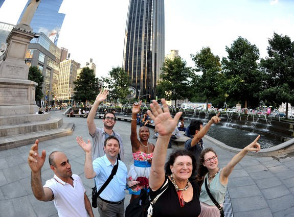 "Members of the Amateur Astronomers Association of New York gathered for a ""flash mob"" in Columbus Circle to wave at Saturn on July 19, 2013."