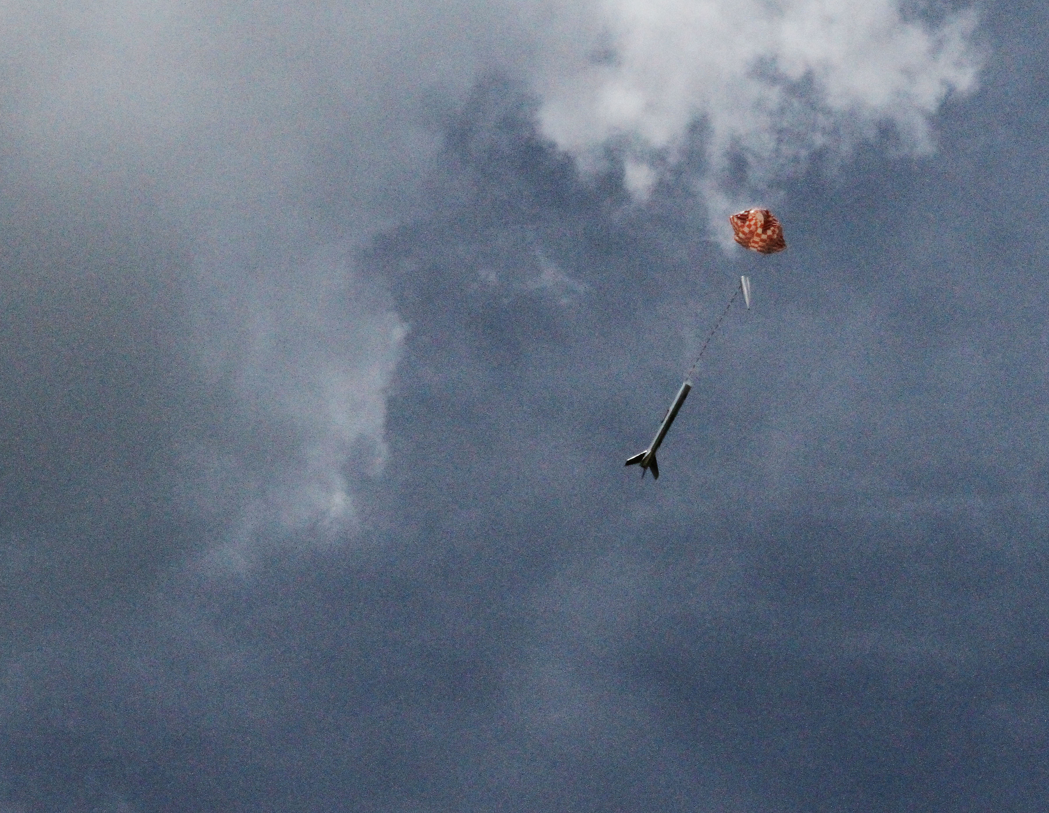 A Model Rocket Parachutes Safely to the Ground