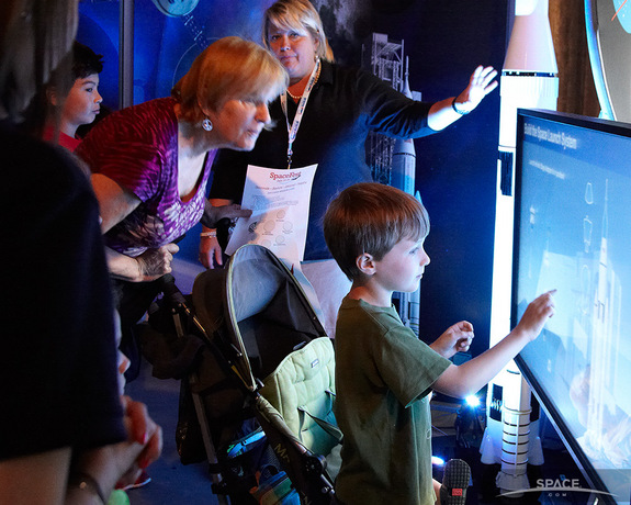 Children explore the interactive exhibits at the Intrepid Museum's SpaceFest, which ran from July 25 to July 28, 2013.