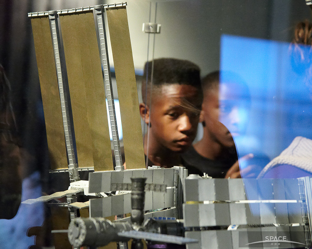 Children Examine International Space Station Model at SpaceFest