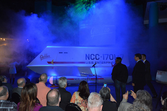 """Star Trek"" superfan Adam Schneider and actor Don Marshall watch as the ""Galileo"" shuttlecraft is revealed at Space Center Houston in Texas, July 31, 2013."