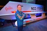 "NASA astronaut Mike Fincke poses with the newly-revealed ""Star Trek"" Galileo shuttlecraft prop at Space Center Houston in Texas, July 31, 2013."