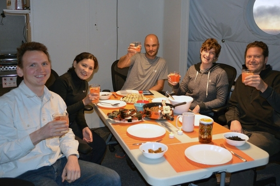 The HI-SEAS mock mission crew members dine together.