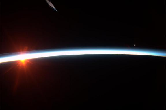 Astronaut Karen Nyberg tweeted this photo of the sunrise and moonrise as seen from the International Space Station. Image released Aug. 4, 2013.