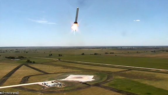 SpaceX's reusable Grasshopper rocket flies sideways during a 100-meter (328-foot) lateral test flight on Aug. 13, 2013 in this still from a video recorded at SpaceX's McGregor, Tex., proving grounds.