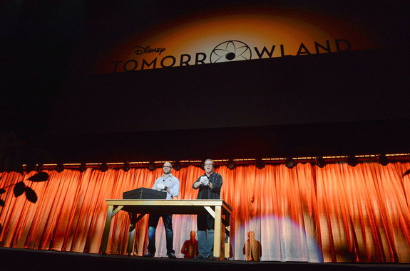 """Tomorrowland"" producer Damon Lindelof (left) and director Brad Bird show off the contents of the ""dusty old box"" for attendees at Disney's D23 Expo in Anaheim, Calif., Saturday, Aug. 10, 2013."