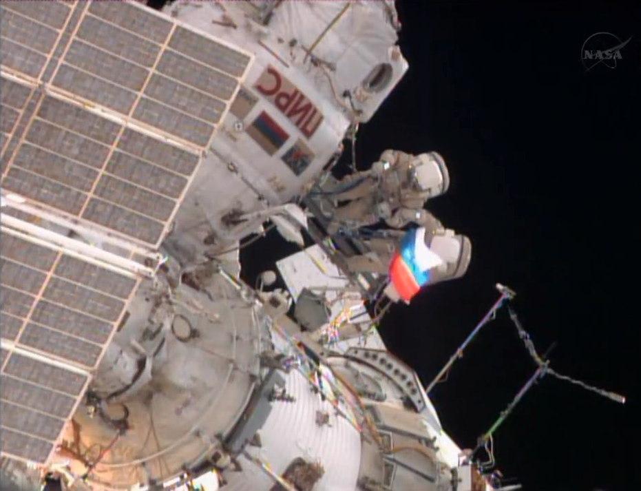 Spacewalking Cosmonauts Wave Russia's Flag in Orbit, Tackle Faulty Gear