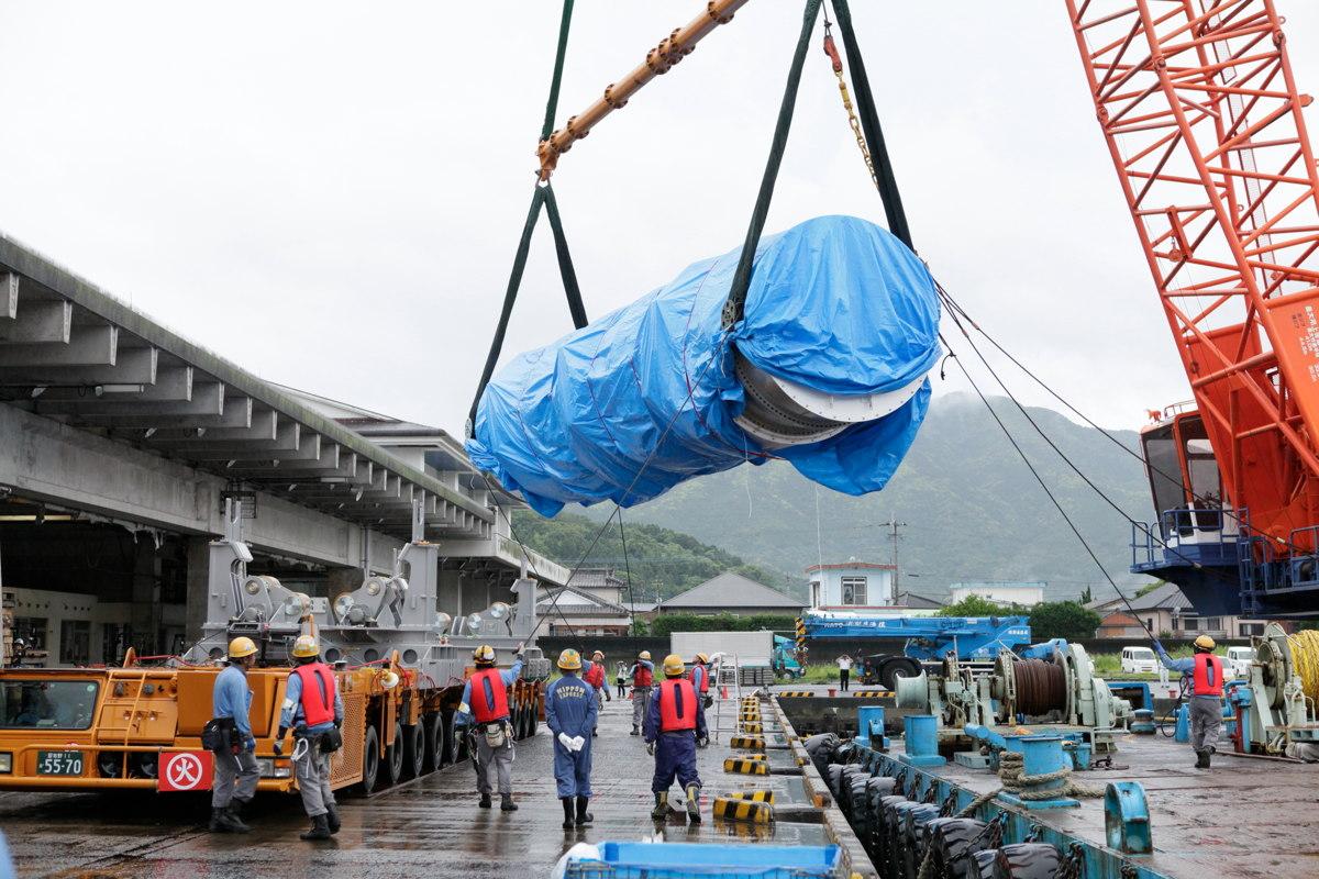 Epsilon Launch Vehicle Hoisted Onto Barge