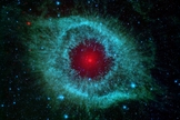 This infrared image from NASA's Spitzer Space Telescope shows the Helix nebula, a cosmic starlet often photographed by amateur astronomers for its vivid colors and eerie resemblance to a giant eye.
