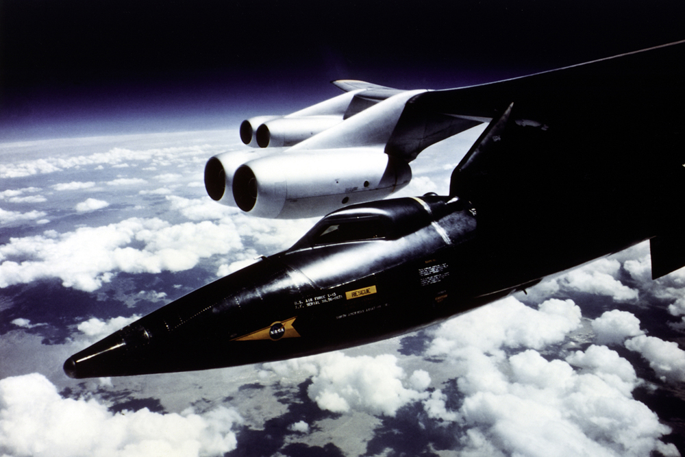 Space History Photo: X-15 Mounted to B-52 Mothership Pylon in Flight