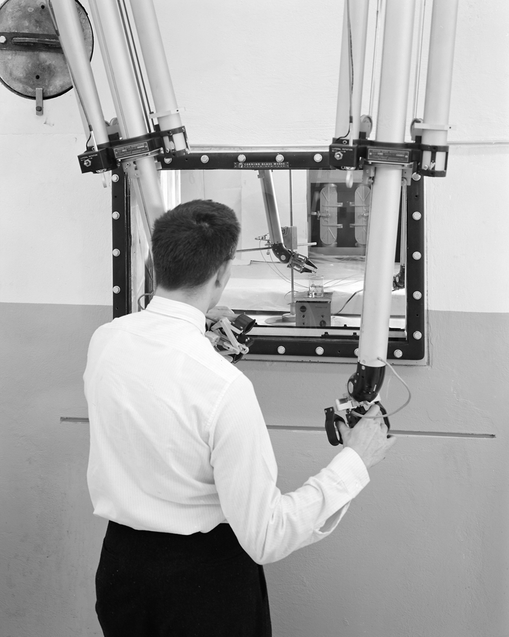Space History Photo: Bob Oldrieve Using Manipulator Arms