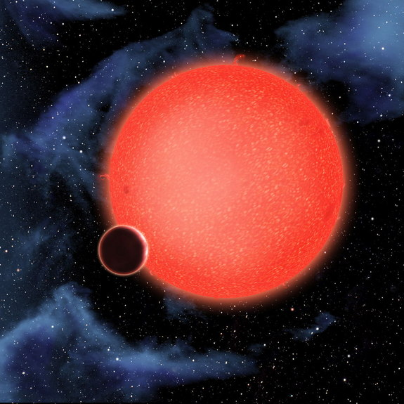 An artist's impression of the super-earth GJ 1214b orbiting close to its star. Astronomers have studied its atmosphere with both the Hubble and Spitzer space telescopes.