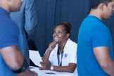 A Virgin Galactic employee interacts with visitors at the company's Career Day event on Sept. 7, 2013, at Mojave Air and Space Port in Mojave, Calif.