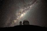 The galactic center and bulge above the ESO 3.6-metre telescope.