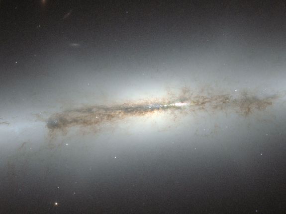 This image from the NASA/ESA Hubble Space Telescope shows edge-on galaxy NGC 4710.