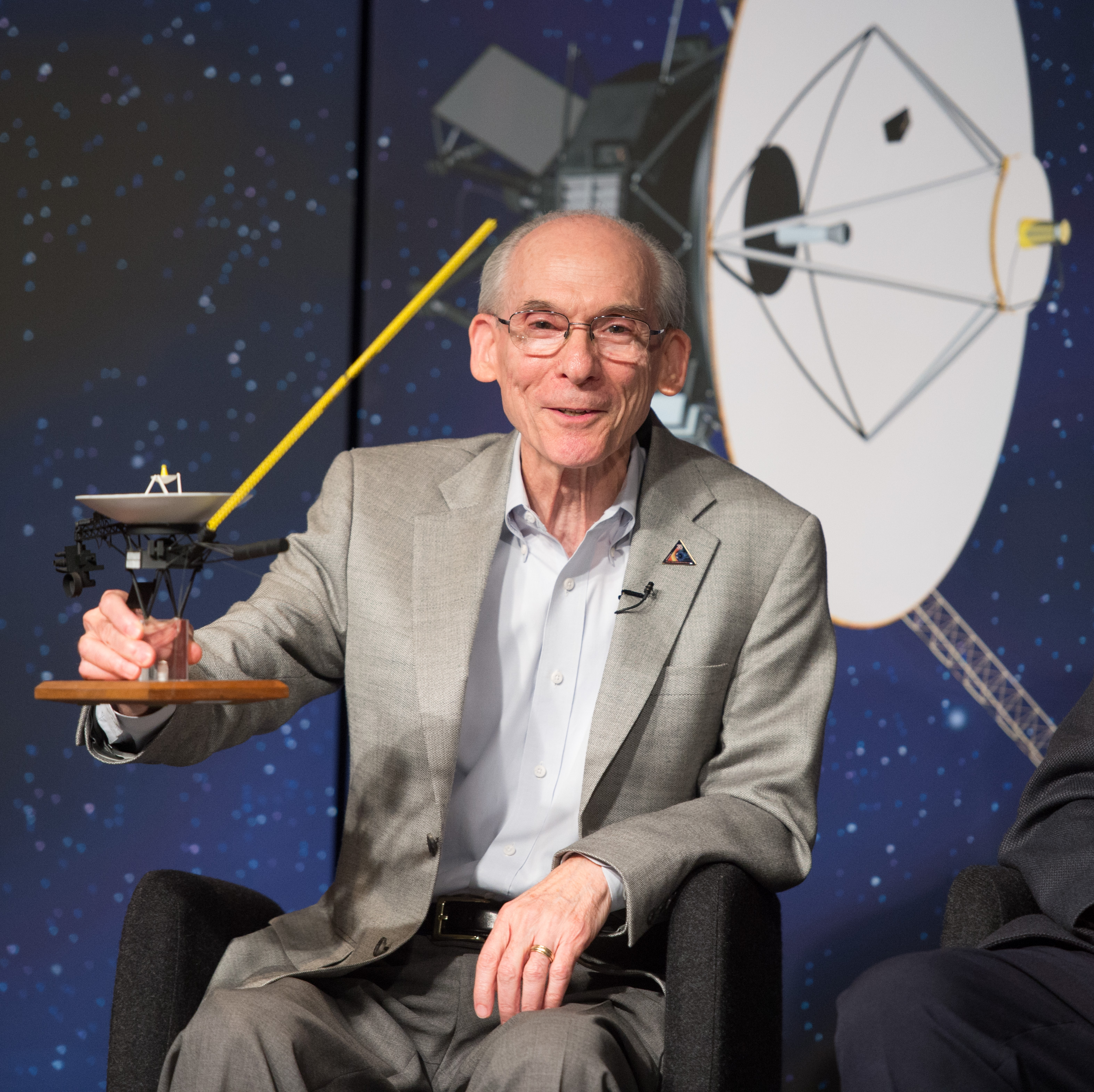 Sept. 12, 2013: Ed Stone Holds Model of Spacecraft at Voyager 1 Conference