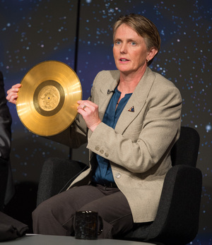 Suzanne Dodd, Voyager project manager, NASA's Jet Propulsion Lab (JPL) holds a replica of the golden record carried on Voyager at a news conference on NASA's Voyager 1 spacecraft, Thursday, Sept. 12, 2013 at NASA Headquarters in Washington.