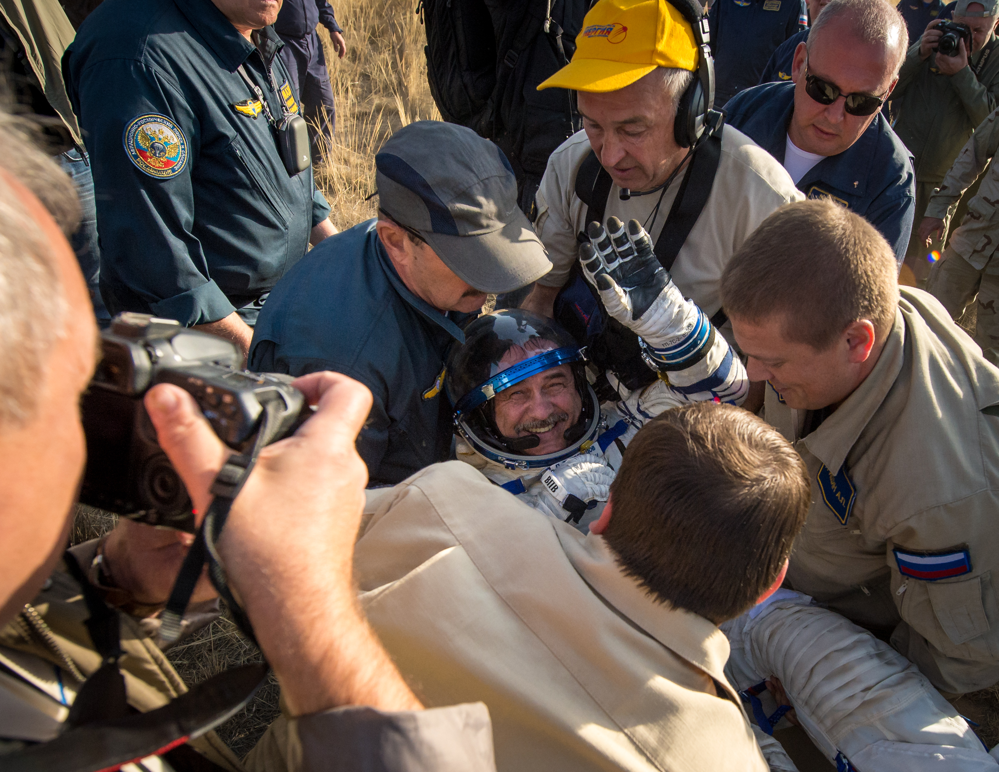 Expedition 36 Commander Helped Out of Soyuz Capsule