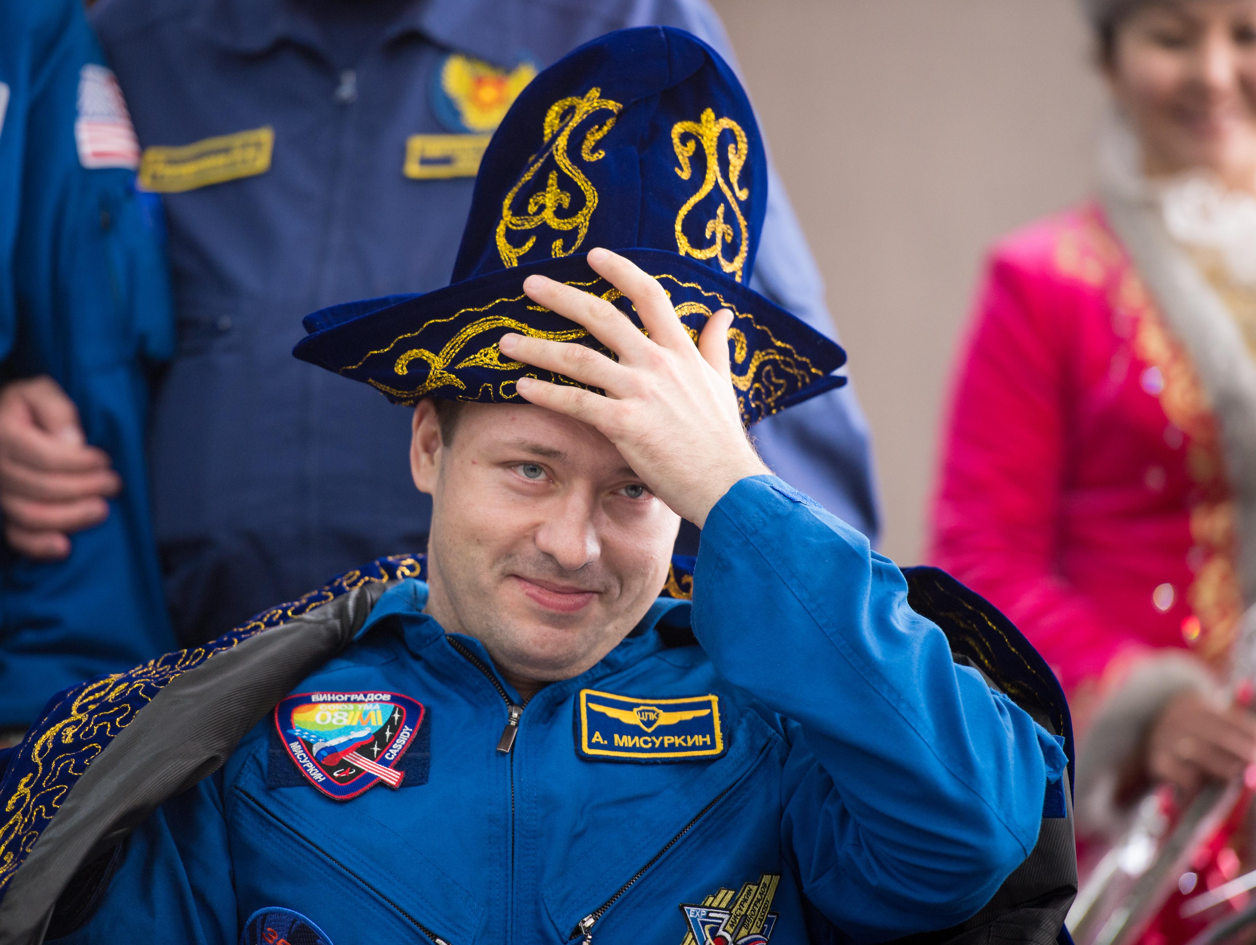 Soyuz Landing: Alexander Misurkin Dons Traditional Kazakh Hat