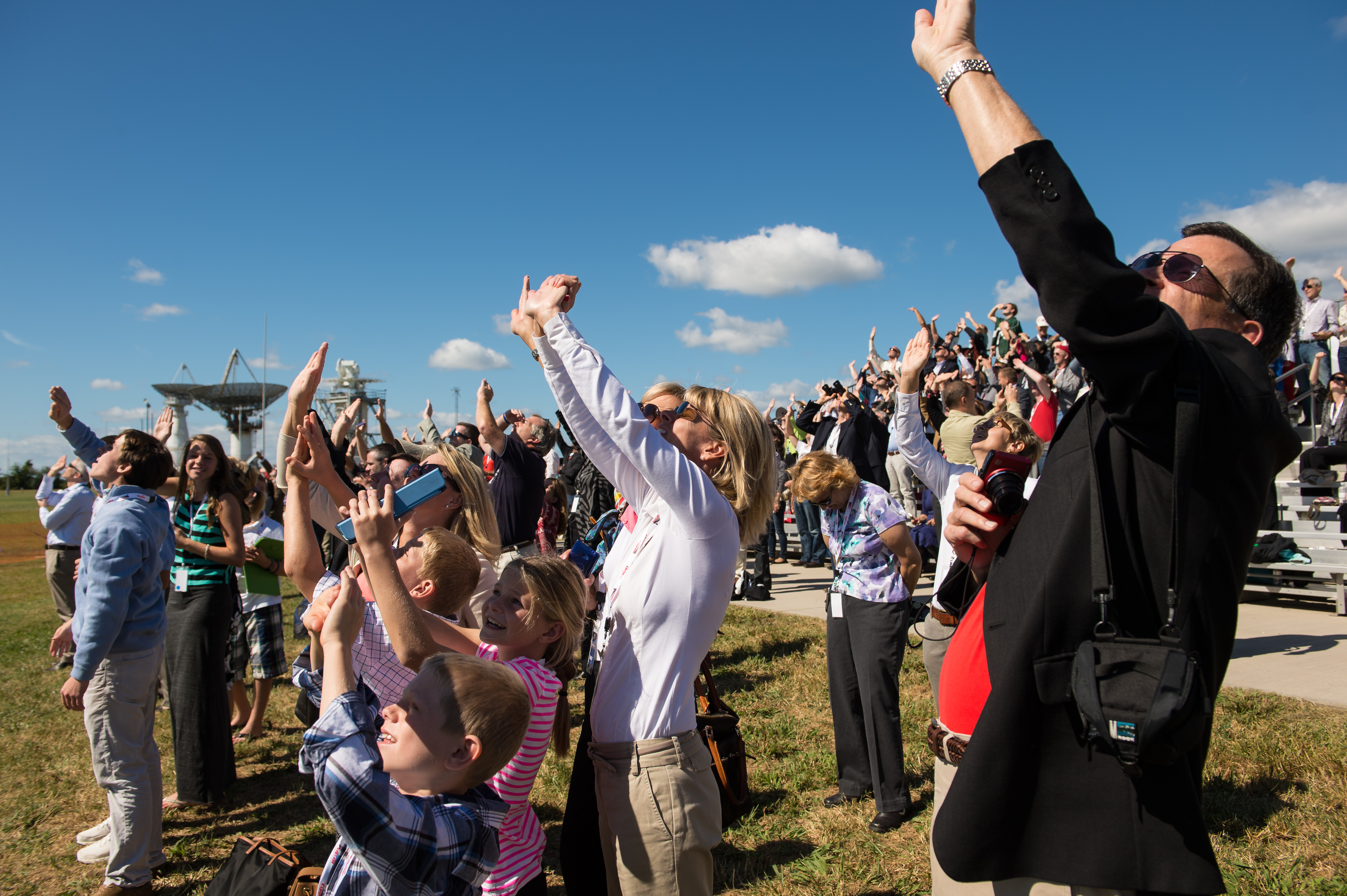 Crowd Watches Antares Rocket Launch