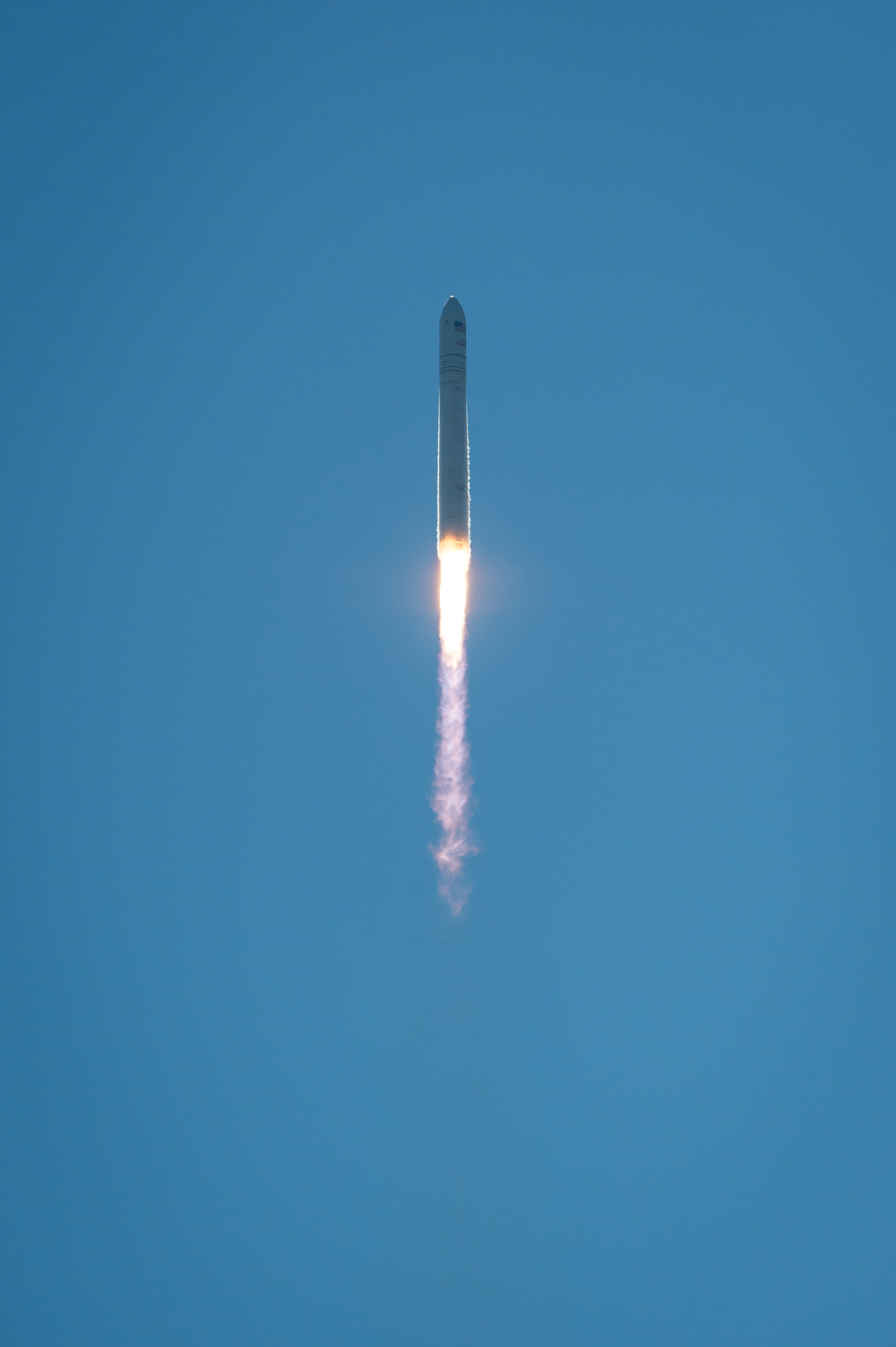 Antares Rocket Soars in Clear Blue Sky