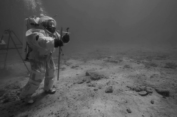ESA astronaut instructor Hervé Stevenin ready to perform soil core sampling with a core tube and a hammer underwater off the coast of Marseille.  During the mission, several soil samples were collected by the aquanauts with similar tools used on the Moon by the Apollo 11 crew. Image released Sept. 10, 2013.