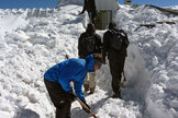 The ArTeMiS space camera team shovel snow to get into the APEX control building on the Chajnantor Plateau in northern Chile. In the foreground is Laurent Clerc, in the middle are Jérôme Martignac (left) and François Visticot (right), and in the background by the door to the building is Yannick Le Pennec.