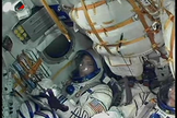 Astronaut Mike Hopkins sits in his seat aboard a Soyuz spacecraft before launching to the International Space Station. Image released Sept. 25, 2013.