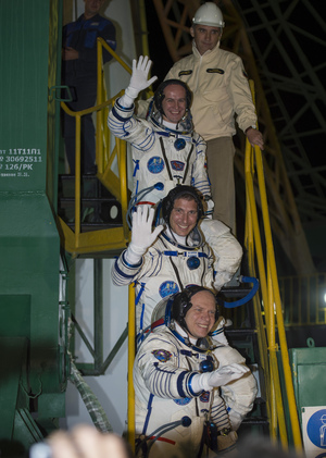 American astronaut Mike Hopkins (center) and Russian cosmonauts Oleg Kotov (bottom)  and Sergey Ryazanskiy wave just before boarding their Soyuz TMA-10M spacecraft during a launch to the International Space Station on Thursday, Sept. 26 from Baikonur Cosmodrome in Kazakhstan. Liftoff occurred at 2:58 a.m. local time, 4:58 p.m. EDT Sept. 25.