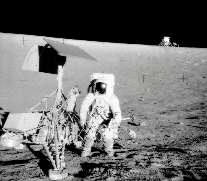 Space History Photo: Conrad and Surveyor on the Slope of a Crater