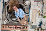 NASA astronaut Karen Nyberg, Expedition 37 flight engineer, poses for a photo while floating freely in the Unity node of the International Space Station on Sept. 16, 2013.
