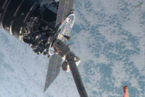 This close-up shows the first Cygnus commercial cargo spacecraft built by Orbital Sciences Corp. attached to the end of the robotic arm on the International Space Station after the two spacecraft met at 7 a.m. ET on Sept. 29, 2013.