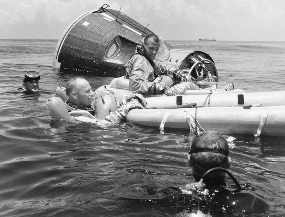 The Prime crew for the Gemini 5 space flight complete practice survival training on July 21, 1965.