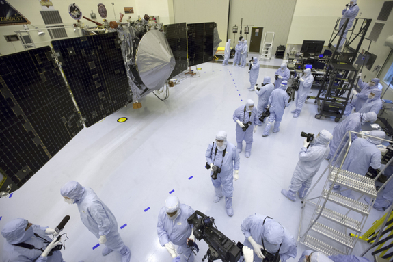 Inside the Payload Hazardous Servicing Facility at NASA's Kennedy Space Center in Florida, reporters and photographers look over the Mars Atmosphere and Volatile Evolution, or MAVEN, spacecraft on Sept. 27, 2013. The Mars orbiter is due to launch on Nov. 17, 2013.