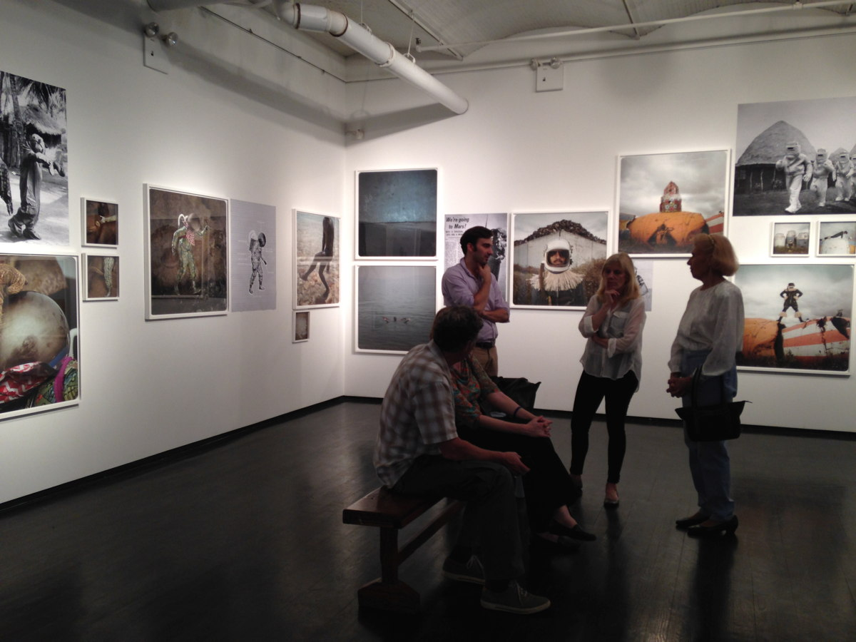 Visitors in 'The Afronauts' Gallery Exhibit