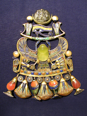 This image shows Tutankhamun's brooch, which celebrates the ancient Egyptian pharaoh with a dazzling scarab made of yellow silica glass, which scientists say was likely formed from a comet impact millions of years ago.