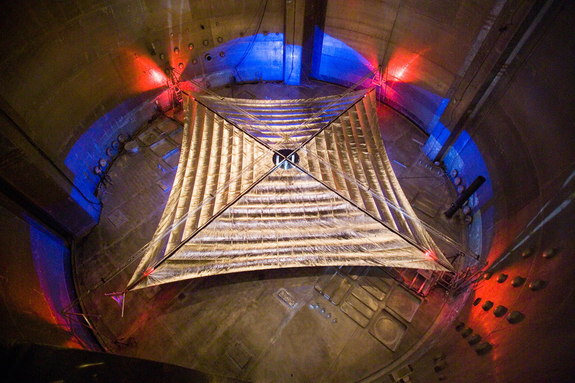 The fully deployed solar sail spans approximately a third the length of a football field.