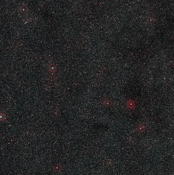 This wide-field image shows the patch of sky around the distant active galaxy PKS 1830-211. This view was created from photographs forming part of the Digitized Sky Survey 2. Image released Oct. 16, 2013.