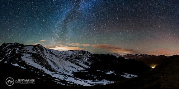 "Colorado-based freelance photographer Jeff Warner captured this seven-image ""stitch"" of the Milky Way glowing over Loveland Pass. The faint, red glow of aurora borealis can also be seen to the right of the photo."