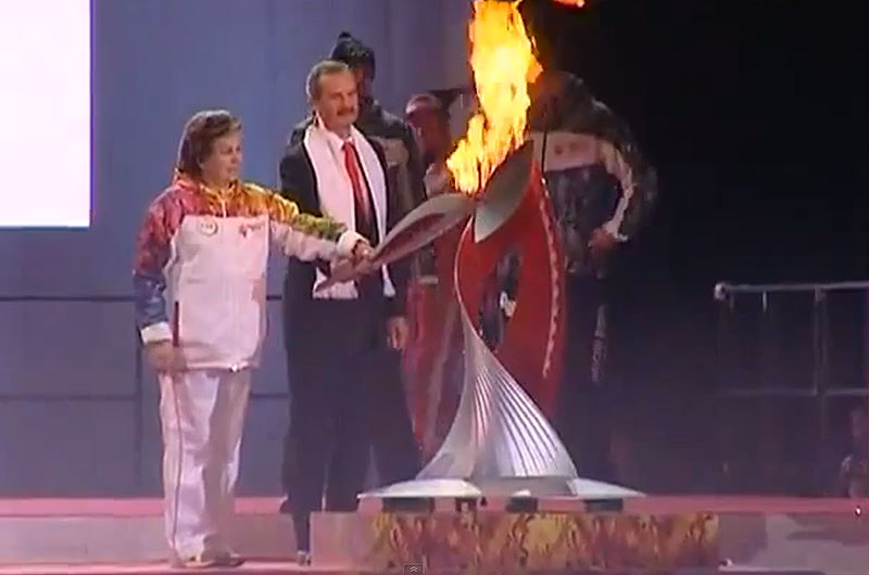 Space-Bound Olympic Torch Heads to Launch Site as Cosmonaut Carries Flame