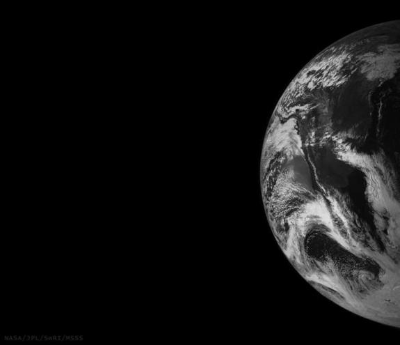 This image of Earth is one of the first snapshots sent back home by NASA's Juno spacecraft during its flyby on October 9, 2013.