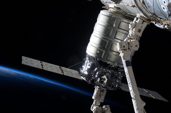 The first Cygnus commercial cargo spacecraft built by Orbital Sciences Corp. is seen here attached to the International Space Station's Harmony node, after arriving at the station on Sept. 29, 2013.