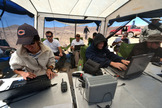Researchers working under shelter during the SAFER trial in Chile's Atacama Desert in October 2013.